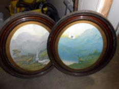 A pair of Edwardian oval framed Highland stag prints