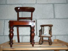 A Victorian style dolls chair and a smaller dolls rocking chair