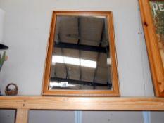 A gilt framed bevel edged mirror