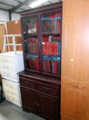 A dark wood stained dresser bookcase with cupboard/drawer base width 84cm depth 42cm,