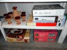 A quantity of new items, Boxed Queen Anne serving dishes, WMF fruit/cake stand etc on 2 shelves.