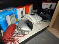 A quantity of telephones plus 2 radio alarm clocks etc.