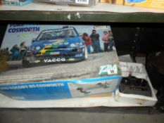 A boxed T2M Ford Escort RS Cosworth remote control car 1/10 scale,