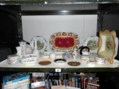 A shelf of porcelain dishes, ornaments etc, including James Kent, Royal Albert etc.