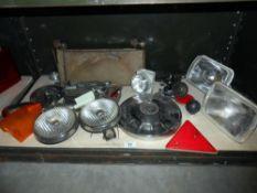 A shelf of vintage/classic car headlights spot lights,
