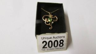 An art nouveau gold and peridot pendant, total approximate weight 3.3 grams.