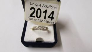 An 18ct (750) 5 stone diamond ring, size P, total approximate weight 3.7 grams.