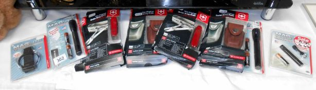 2 boxed Victorinox 33 function Swiss Champ Army knives and 2 leather pouches and quantity of mini