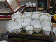 14 pieces of Devonware Fieldings poppy tea ware.