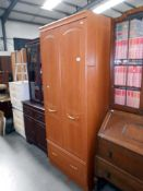 A modern teak effect double door wardrobe with drawer 76cm x 51cm x height 190cm