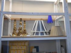 A pair of brass lamps,