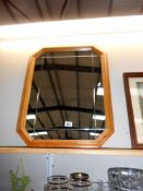 An 8 sided pine framed mirror with deep cut decoration,