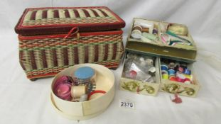 A needlework basket and a quantity of needlework items.