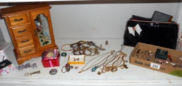 A jewellery cabinet and assortment of costume jewellery etc.