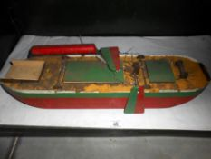 A vintage wooden model of a boat a/f length 59cm