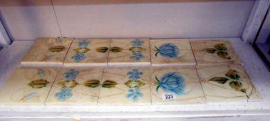 A set of art nouveau decorated fire place tiles a/f (3 glued back together)