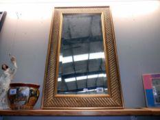 A bevel edged gilt framed mirror, height 75cm,