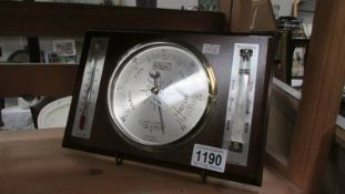A modern barometer/thermometer.