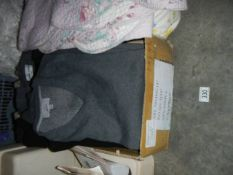 A quantity of men's sweaters.