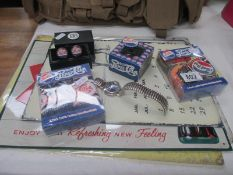 A selection of Pepsi Cola items including sign, cufflinks,