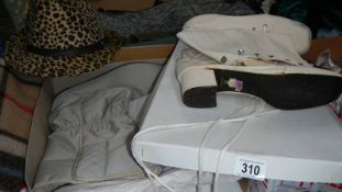 A pair of ladies boots and hat.
