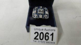 A costume ring set blue stones, size J.