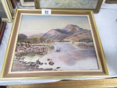 An oil on canvas lake and mountain scene, image 26 x 21, frame 32 x 28.