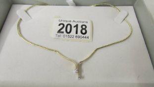 A pretty diamond 2 stone necklace in 9ct yellow gold.