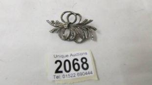 A silver marcasite brooch.