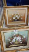 A pair of oil on canvas floral studies signed R Cox and Contaul, 35 x 29 cm.