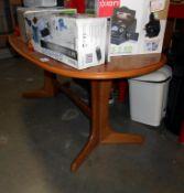 An oak oval coffee table 55cm x 110cm,