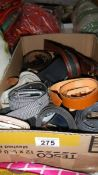 A box of assorted belts.