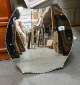 A horse shoe shaped bevel edged mirror in good condition, 46 x 47 cm.