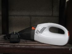 A portable hand held Vax vacuum cleaner,