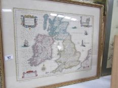 A framed and glazed map of England, Ireland and Scotland.