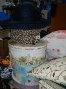A quantity of hats and hat boxes.