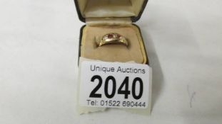 A Victorian hall marked gold and ruby ring, size N. 2.8 grams.