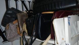 A shelf of assorted handbags.