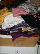 A large mixed lot of scarves.