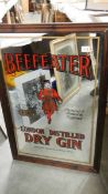A large Beefeater Gin advertising mirror. 64 c 96 cm (collect only).