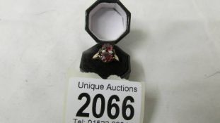 An antique 15 ct red stone and pearl ring, size M half, 2.6 grams.
