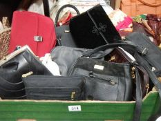 A box of good quality hand bags.