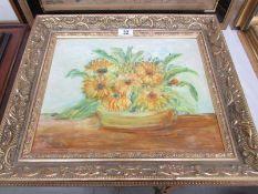 A gilt framed oil on board 'Marigolds' signed H Richardson. Image 36 x 29 cm, frame 47 x 40 cm.