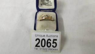 An antique 15 ct gold ring set sapphire and pearl, size P, 2.7 grams.