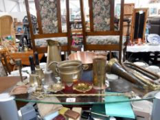 A selection of brass and copper including early bugle a/f, grandfather clock bell, Sankey jug etc.