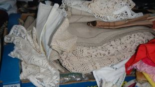 A mixed lot of beige table runners, mats etc.