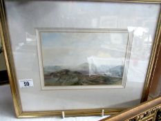A framed and glazed watercolour mountain scene signed Lauder, image 22 z 15 cm, frame 41 x 35 cm.