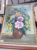A framed vase of flowers study signed Reaveley, 66 x 47 cm.