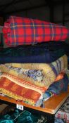 A quantity of picnic blankets.