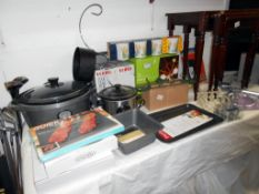 A quantity of kitchenalia including slow cooker plus some new bathroom items